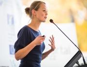 woman giving technology leading speech